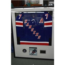 Professionally framed New York Rangers hockey jersey signed by No.7 Rod Gilbert, complete with COA f