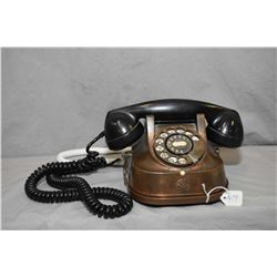 Vintage brass and copper rotary dial phone marked RTT 56