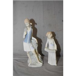 """Two Nao figurines including an angel with a squeeze box and a girl leaning on a fence 11"""" in height"""