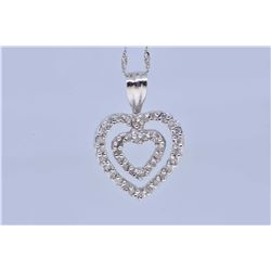 Lady's 10kt white gold and diamond heart shaped pendant on a 10kt white gold neck chain