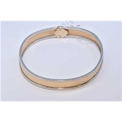 Lady's 10kt yellow gold and white gold hinged bracelet