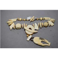 """22"""" elephant ivory beaded necklace with ivory scrimshaw pendant"""