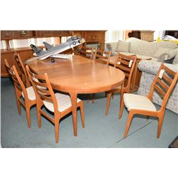 Mid century Danish teak dining table with three insert leaves made by C. J. Rosegaarden and eight un
