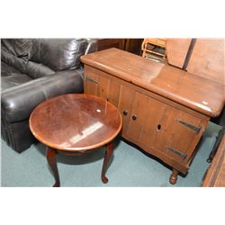 Tudor style two door server and a semi contemporary round occasional table with cabriole feet