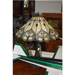 Pair of antique style cast table lamps with stained and leaded glass shades