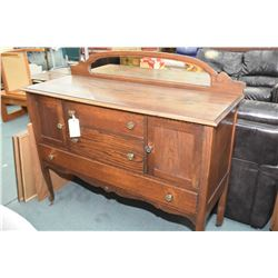 Antique Canadiana oak sideboard with mirrored backboard, standing on tall cabriole supports