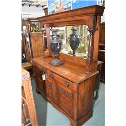 Antique Art Nouveau sideboard with carved panels, topped with tall bevelled mirrored backboard, reed