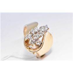 Lady's 14kt yellow gold and diamond ring, set with 0.50cts of brilliant white diamonds. Retail repla
