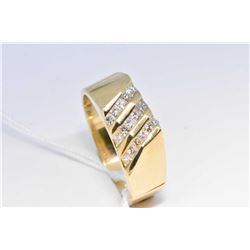 Lady's 14kt yellow gold and channel set diamond ring set with 0.55cts of brilliant white diamonds. R