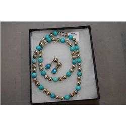 Turquoise and sterling silver 25' beaded necklace and a pair of turquoise and sterling earrings