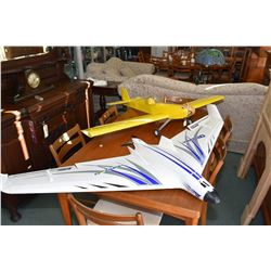 Two flying model airplanes including a foam Opterra E-Flite and a covered wood low wing electric pow