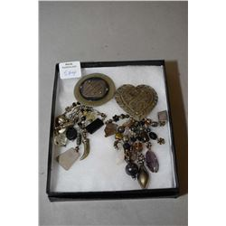 Two vintage David Navarro brooches, both with hanging beads and artefact style charms