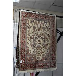 Wool area carpet with geometric floral center section, multi borders in hues of cream, copper, taupe