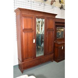 Antique three piece two door wardrobe with two drawer base and full length bevelled mirror in center