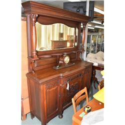 Antique sideboard with nouveau influenced carving, tall backboard with bevelled mirror and turned co