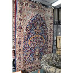 Wool area carpet with tree of life pattern in shades of blue, cream, reds, yellows, orange etc. 73""