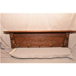 "French heavily carved oak wall rack with five hooks and dual plate groves on upper shelf, 43"" wide"