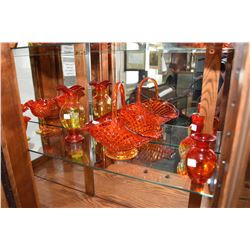 Eighteen pieces of vintage amberine glass including baskets, vases, candlestick, comports etc.