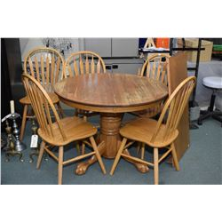 Semi contemporary oak center pedestal dining table with insert leaf, and ball and claw pedestal base