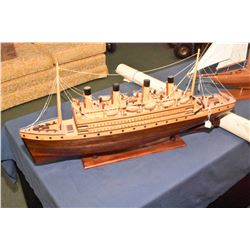 "Two handmade wooden ships including a sailboat and a 32"" ocean liner plus a three piece 6"" X 9"" Nati"