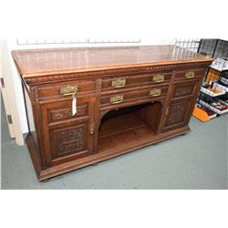 Antique quarter cut oak sideboard with two carved raised panel doors and four drawers surrounding op