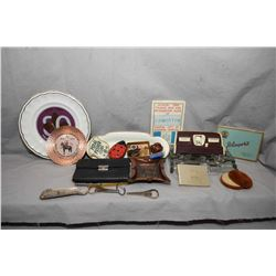 Selection of collectibles including RCMP tray, Boy Scouts plate, antique leather pocket book, presse