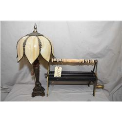 Reproduction log roller and a cast table lamp with slag glass shade
