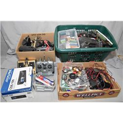 Three containers of remote control hobby accessories including seven controllers, batteries and char