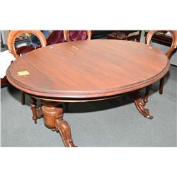 Antique double pedestal mahogany crank dining table with carved scrolled accented pedestals and 21""