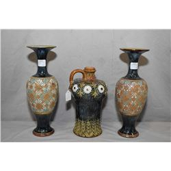 "Three pieces of antique Doulton Lambeth including a pair of Slater Lambeth 10 1/2"" high vases and a"