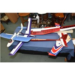 Four model airplanes in Styrofoam and wood