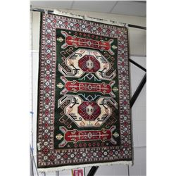 100% wool area rug with geometric center section and multi borders, emerald green background with hi