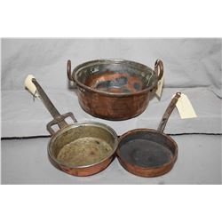 Three pieces of antique copper including double handled pot and two skillets, each with hammered iro