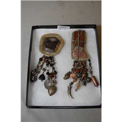 Two vintage David Navarro brooches including concho style medallion with hanging beads and charms an