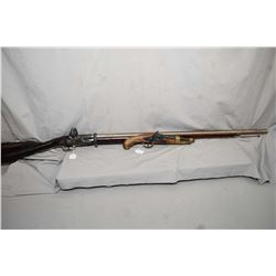 Two replica flintlock firearms including a rifle and a pistol