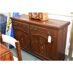 Antique sideboard with two raised panel carved doors and two drawers