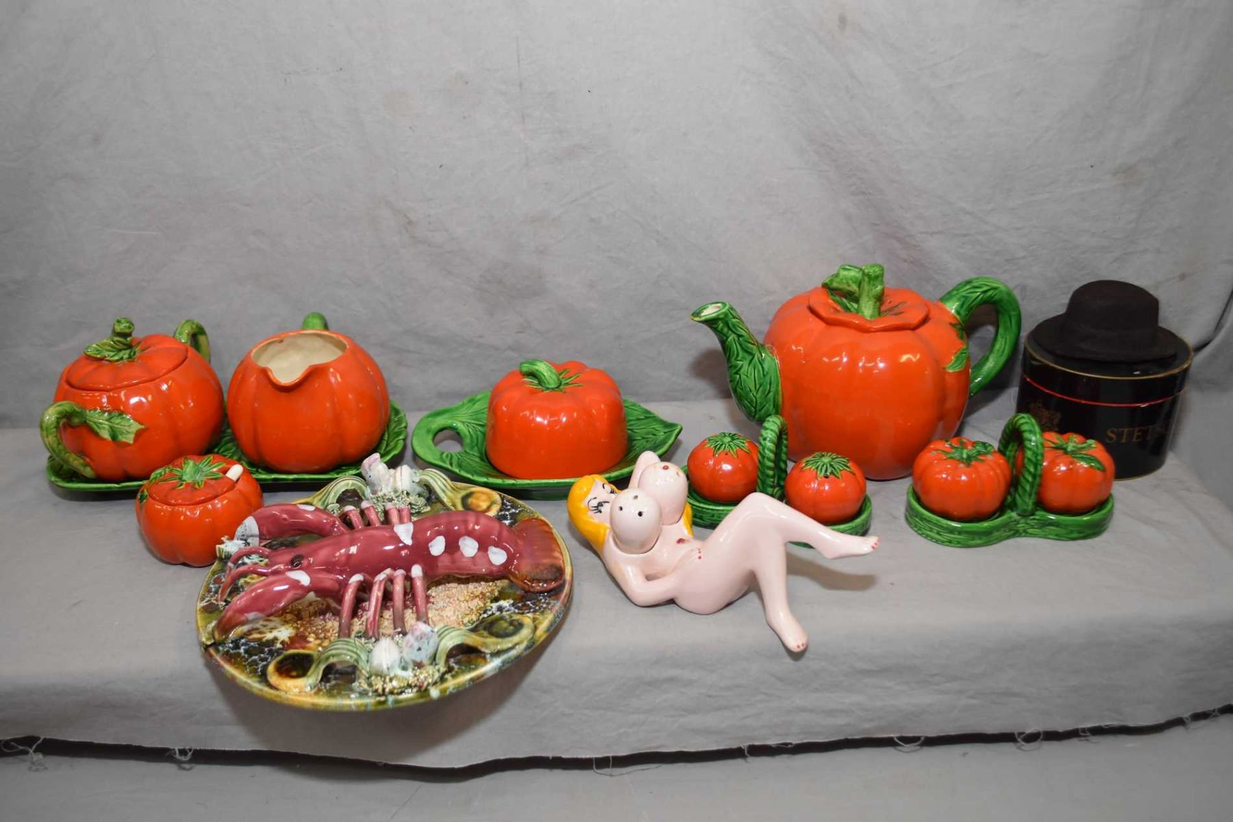Selection of vintage Tomatoware including teapot, lidded sugar and