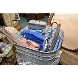 Galvanized washtub containing a selection of man's collectibles including horse shoes, vice, hand cr
