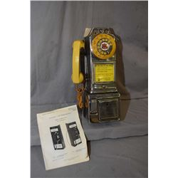 An Automatic Electric Co. chrome plated coin operated telephone in a Northern Electric cardboard box