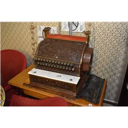 Antique National cash register and a treadle sewing machine base