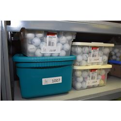 Four tubs of golf balls