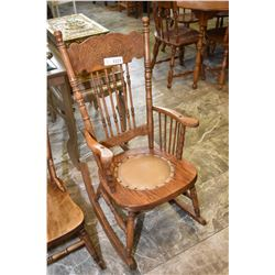 Pressed back oak armed rocking chair