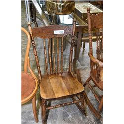 Press back open arm rocking chair