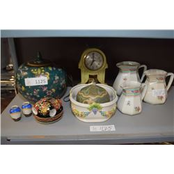 Shelf lot of collectibles including three piece graduated pitcher set, electric clock, framed prints