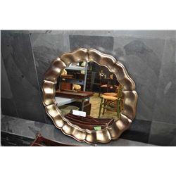 Modern wall mirror in sculpted silver frame