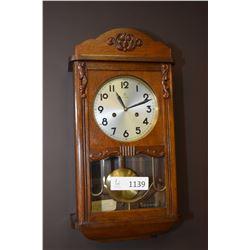 Oak cased chiming wall clock