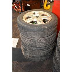 Set of four Assurance mud / snow tire, size P175/65R 15 mounted on aluminum Mini Cooper rims