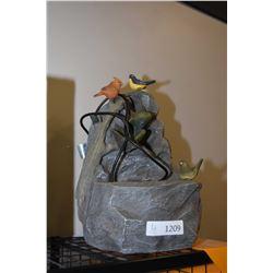 Simulated rock bird motif water fountain