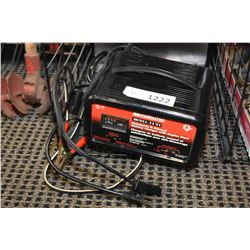 Appears new but not in box Motomaster automatic and manual battery charger with engine start