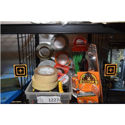 Large selection of assorted sticky tapes including Gorilla, masking tape, duct tape, tub o' zip ties